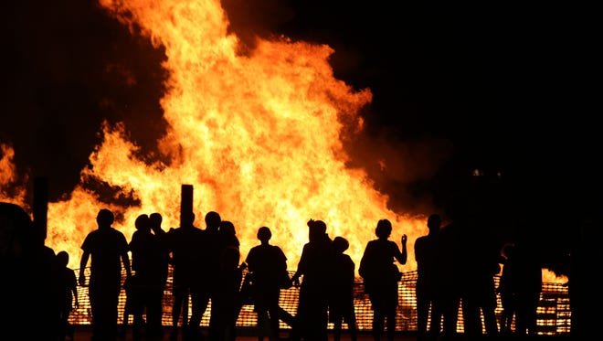 Students are cleared to have a bonfire to kick off homecoming.