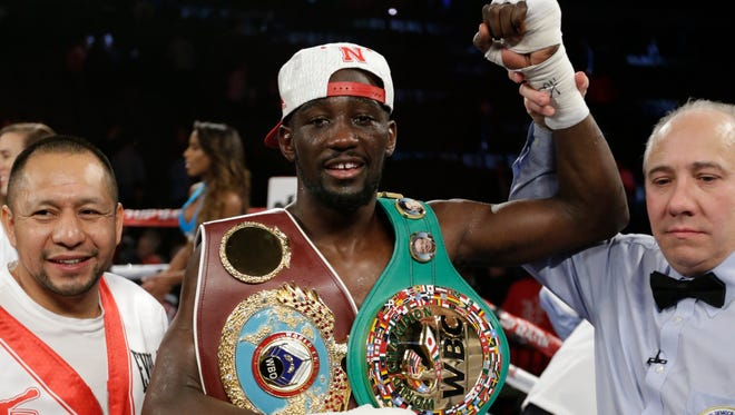 Terence Crawford is declared winner over John Molina Jr. after a WBO junior welterweight boxing bout in Omaha on Dec. 10, 2016.