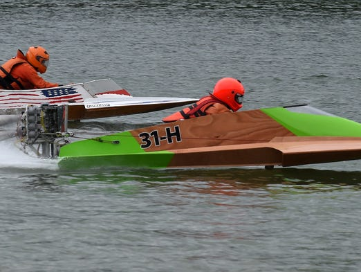 Racers test their engines Thursday, July 31, 2014, at Pigeon Creek during practice runs for Buzz on Pigeon  Creek National Boat Racing Championships.