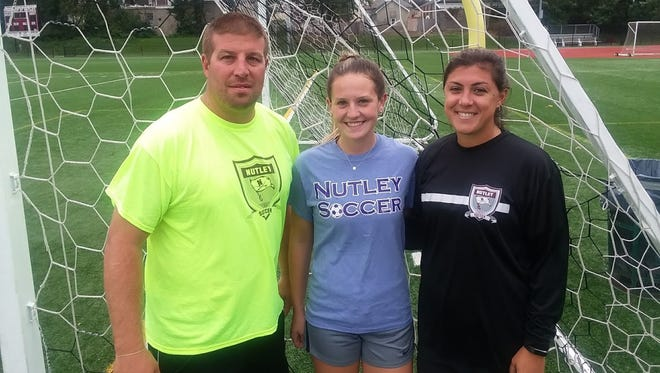 Nutley girls soccer (from left) coach Mike DiPiano, team captain Maisie Jelley and assistant coach Adina Corasaniti.