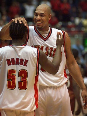 Iowa State's Marcus Fizer, right, celebrates with teammate Michael Nurse during the final seconds of their 89-77 win over Texas, Tuesday night Feb. 22, 2000, in Ames, Iowa.
