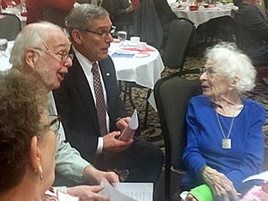 Former Elmira Mayor James Hare, left, and Chemung County Executive Tom Santulli serenade Mildred Ruger at her 104th birthday party.
