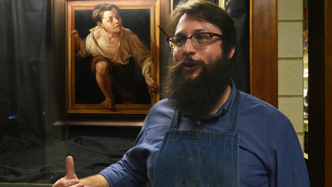 "Fine arts teacher Matthew Daniels of Millville Senior High School for the last month has used the painting behind him to techniques to make subjects appear to be in motion. Daniels, who used to do murals for the city of Philadelphia, said the school got the painting on loan a month ago from the nonprofit True Renaissance. It is an actual oil painting done at the Louvre Museum in France of a painting in that museum's collection. The original painting is ""Escaping Criticism"" by Catalan artist Pere Borrel del Caso."