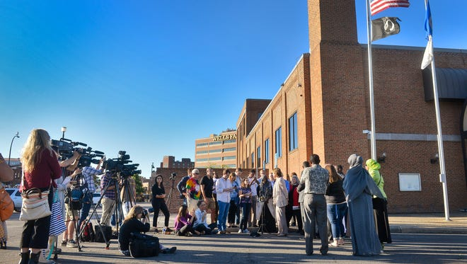 Area community and faith leaders gather Monday evening outside St. Cloud City Hall for a press conference in the wake of the weekend mall stabbings