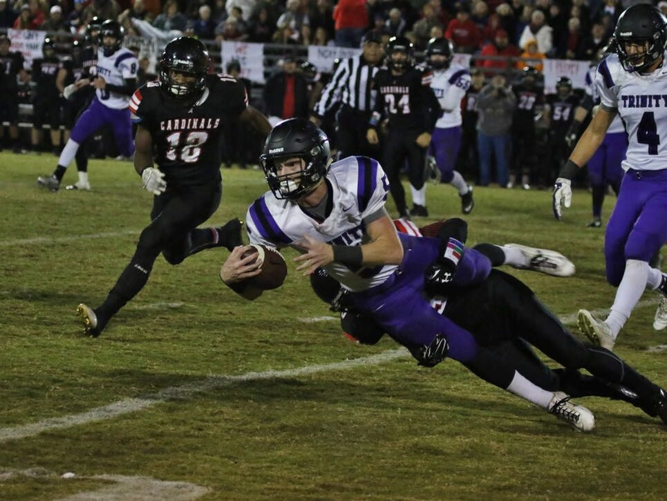 Trinity Christian's Eli Parker reaches out for a gain against Adamsville.