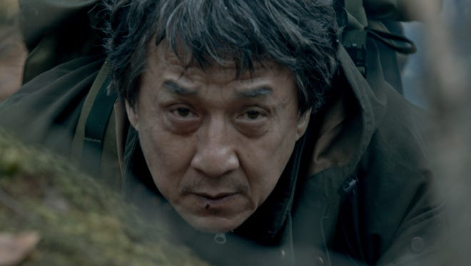 Jackie Chan's Quan waits for his moment to attack in 'The Foreigner.'