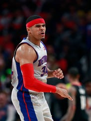 Pistons forward Tobias Harris reacts after a 3-point