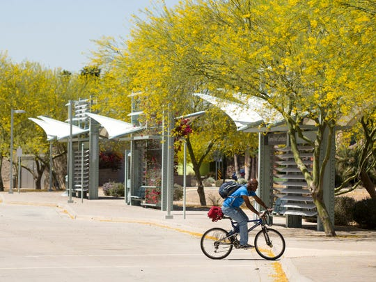 Trees and shade sails provide relief from the sun at