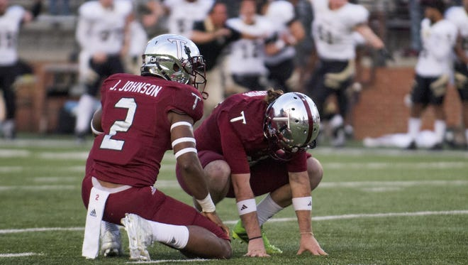 Kicker Jed Solomon and holder John Johnson react after a last-minute field goal attempt hit off an upright, sealing Troy's 19-16 home loss to Idaho in October 2015.