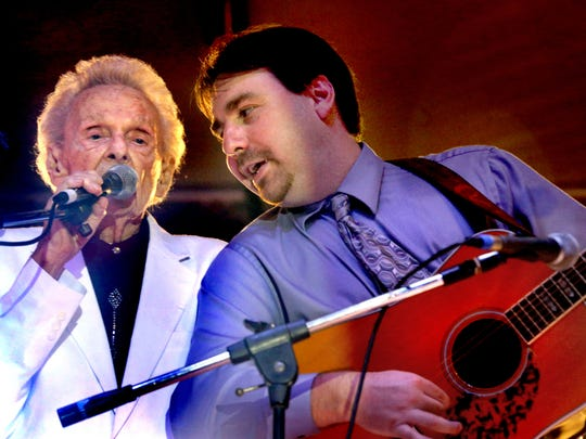Ralph Stanley,left sings with his son Ralph Stanley II on their final song during the opening night of the Uncle Dave Macon Days Festival, on Friday, July 10, 2015.