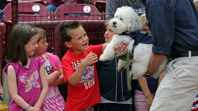 Hank the Dog — or should we say Hank 1 — meets young fans during a visit last year to Fox Cities Stadium in Grand Chute.