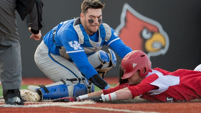 Louisville Cardinal infielder Tyler Fitzgerald (2) is tagged out by Kentucky Wildcat catcher Kole Cottam (13) during the game played at Jim Patterson Field on the campus of The University of Louisville, in Louisville, Ky, April 17, 2018