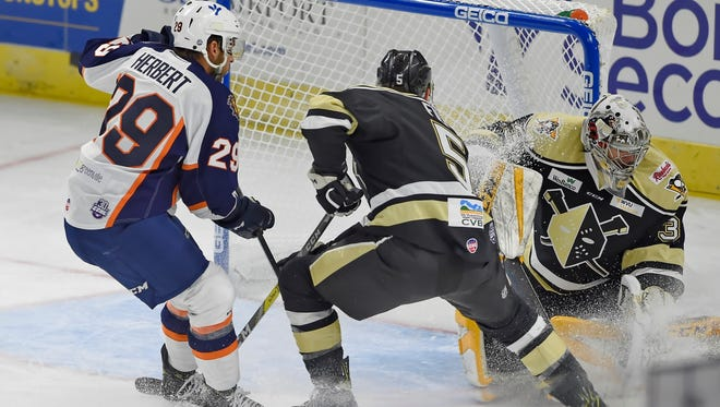 Caleb Herbert (29) had a goal and two assists in his Swamp Rabbits debut Friday night.