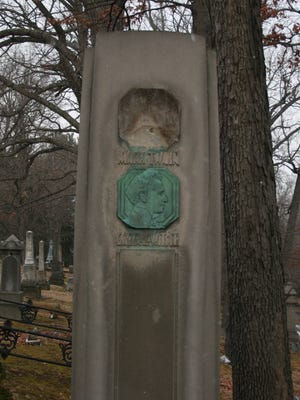 The bronze profile portrait of Mark Twain was removed from the noted author's stone monument in Woodlawn Cemetery. Twain's plaque was placed above that of his son-in-law.