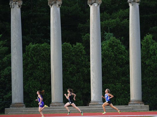 Runners pass columns at the track venue during the 800-meters at the IHSAA state high school girls track championships at Robert C. Haugh Track and Field Complex in Bloomington, June 1, 2013.