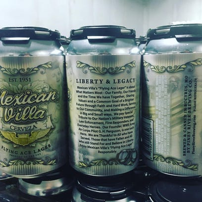 Cans of Flying Ace Lager, a beer from Piney River Brewing