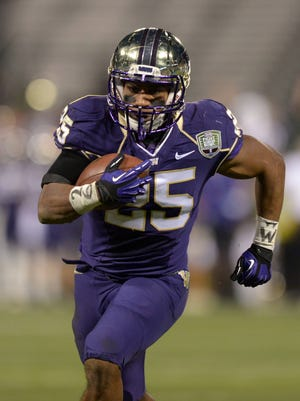 Washington Huskies tailback Bishop Sankey (25) scores on a 12-yard touchdown run in the first quarter against the BYU Cougars in the 2013 Fight Hunger Bowl at AT&T Park.