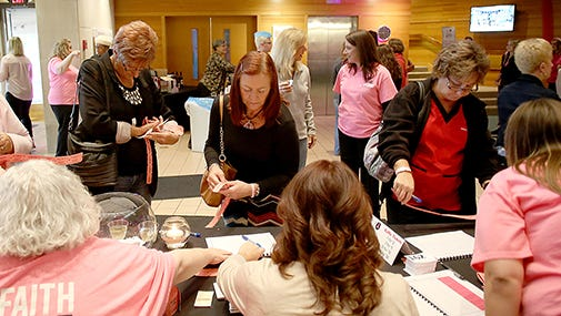 A large number of people showed up for the Wine, Dine & Unwind event Thursday at Minnetrista.