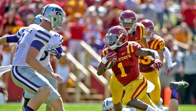 Iowa State's Jarvis West, right, made a sharp cut to the center of the field to elude Kansas State defenders as West scored his team's second touchdown on punt return during football game at Jack Trice Stadium in Ames on Saturday Sept. 6, 2014.