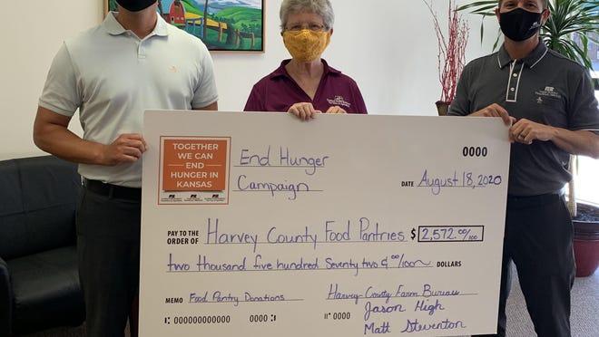 From left are Matt Steventon, Farm Bureau Financial Service; Margaret Goering, Harvey County Farm Bureau; and Jason High, Farm Bureau Financial Service.