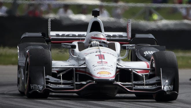 Team Penske's Will Power (1) rounds the second turn of the day's Angie's List Grand Prix of Indianapolis, Saturday, May 9, 2015.