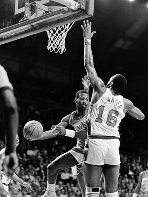 FILE - In this April 17, 1984, file photo, Atlanta Hawks' Eddie Johnson looks for help as he tries to get around Milwaukee' Bucks' Bob Lanier during NBA basketball playoff game action in Milwaukee. Johnson, the two-time All-Star for the Hawks whose career was shortened by arrests which led to a life sentence in prison, has died. He was 65. (AP Photo/Tom Lynn, File)