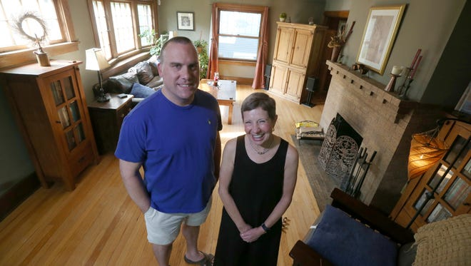 James Lohrey, current home owner of 53 Girton Place in Rochester, with Nancy Rutherford, Brighton, who originally owned the house in 1980, and recently bought back the home from Lohrey and husband Jeffrey Feinberg, Friday, June 1, 2018.