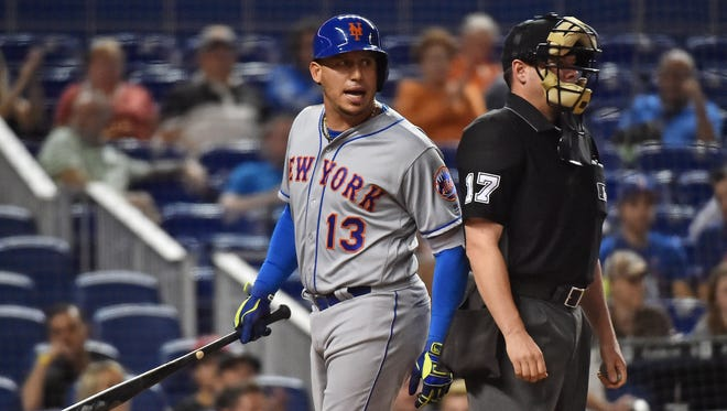 New York Mets second baseman Asdrubal Cabrera (13) reacts after striking out in the first inning against the Miami Marlins at Marlins Park.