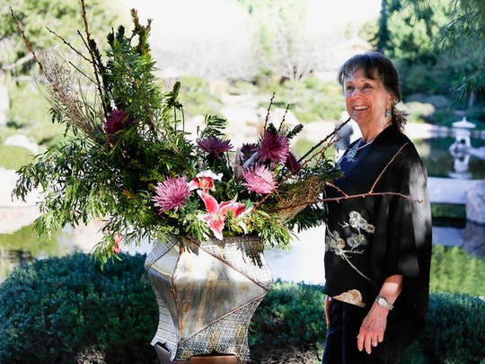 Carol Brecker at the Japanese Friendship Garden in Phoenix with an ikebana display she created.