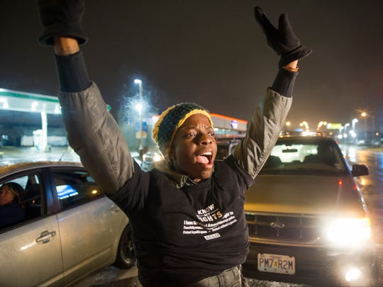 Protesters shut down a street Nov. 23 near where Vonderitt Myers Jr. was killed by an off-duty St. Louis police officer.