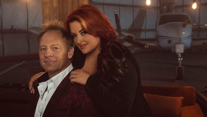 Wynonna Judd, right, with her husband, producer/drummer