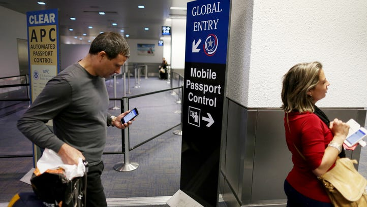 A sign points passengers  to the mobile passport control