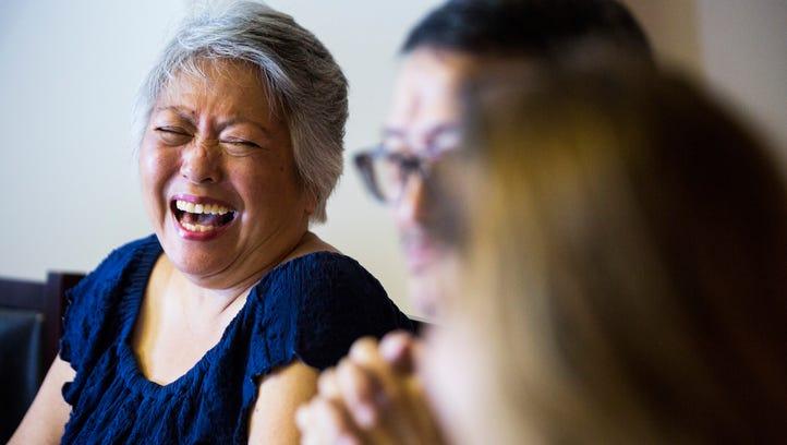 Julie Wang laughs heartily during an improvisational