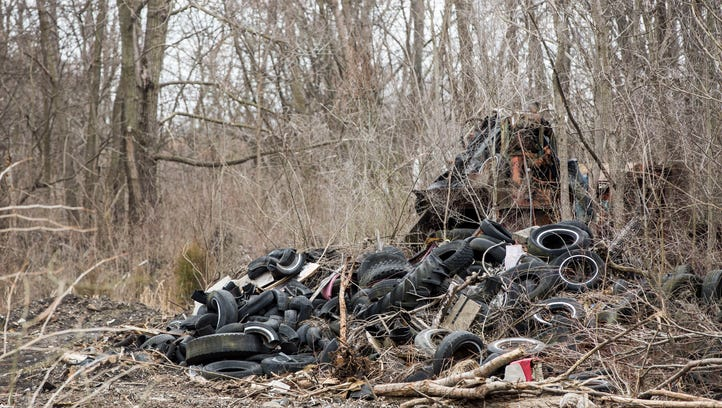 Tire dump remains behind new Fresh Thyme grocery