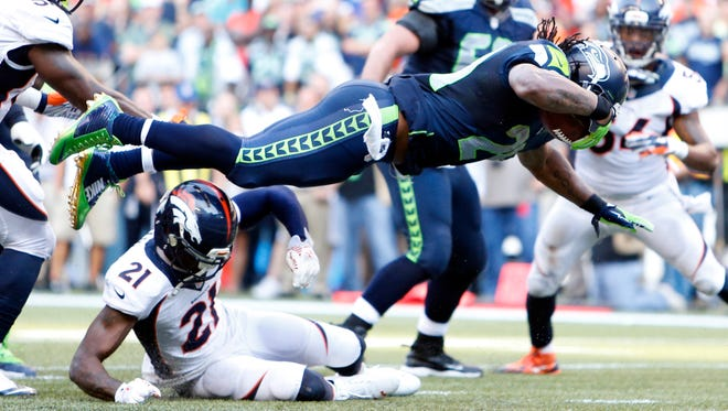 Seattle Seahawks running back Marshawn Lynch (24) scores the game-winning touchdown in overtime against the Denver Broncos.