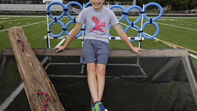 "Cole Stoffel, a 12-year old Appleton resident, sits with obstacles for this Saturday's ""Cole's Cancer Crusade"" event at Appleton East. The kids' obstacle course will raise money for pediatric cancer."