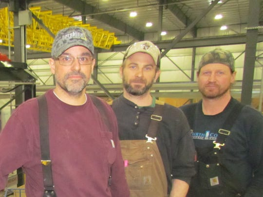 Seasoned Freres employees, from left, Ed Setzer, Zach Holman and Randy Carson. Experienced help has been crucial to getting a new plant up and running.  Freres Lumber Company achieved an ambitious timeline in getting its Mass Plywood Panel plant operational by Christmas.