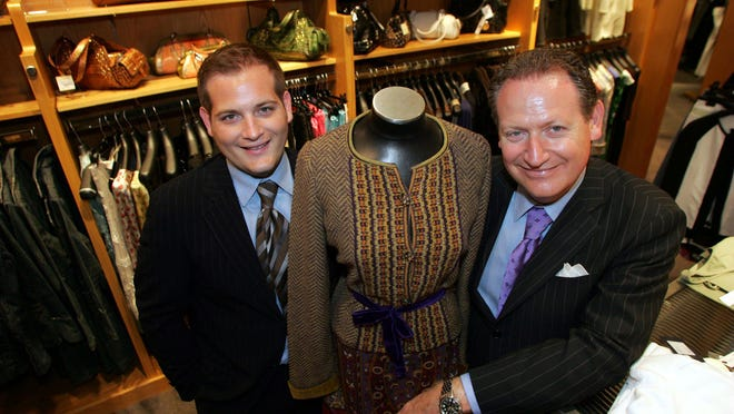 Johnell Garmany (left) and his father, Larry Garmany, in their Red Bank clothing store, Garmany, in 2005. The elder Garmany died suddenly Saturday.