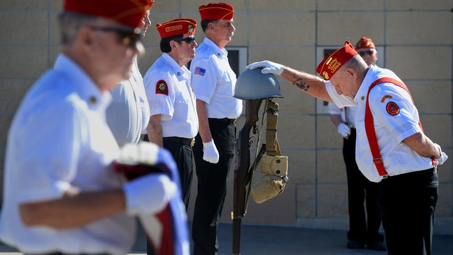 An honor guard ceremony is performed by the Marine Corps League Honor Guard during the memorial service for James Dickinson on April 7.