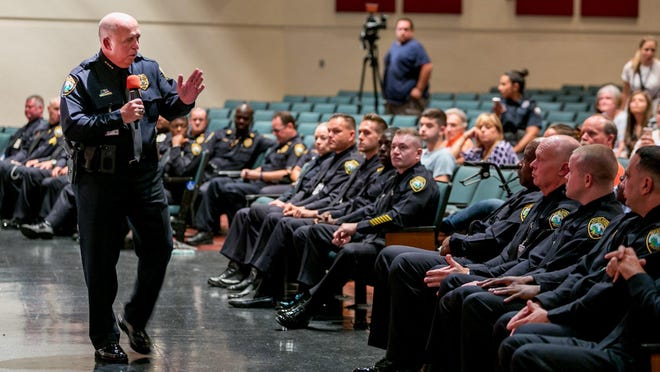 Chief Frank Kitzerow speaks to new Palm Beach County school district officers before swearing them in last year.