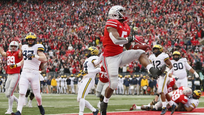 Ohio State will play rival Michigan on Dec. 12 in Ohio Stadium. The last time the Buckeyes hosted the Wolverines, in 2018, running back Mike Weber's third-quarter touchdown helped OSU roll to a 62-39 win.