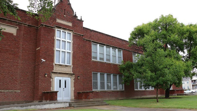 The USD 489 school board voted Monday to officially close Washington Elementary School. The closure of the school moves Overland Property Group one step closer to its goal of renovating the building into affordable housing apartments.