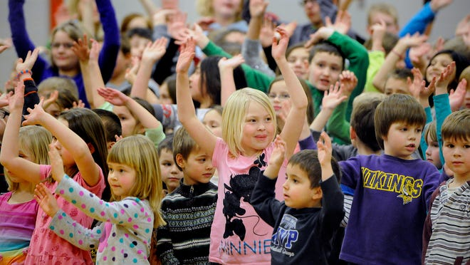 Rice Elementary School students take part in a dancing game during Friday's yumPower nutrition program in the school's gymnasium. The HealthPartners program is designed to entourage kids to eat more fruits and vegetables.