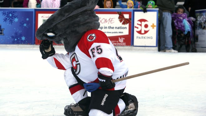 Cyclones mascot Twister celebrates like Tim Tebow during the 2015 Mascot Broomball game on Fountain Square.