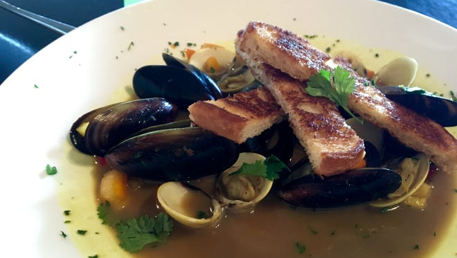Mussels and clams in a coconut-curry sauce from Pickled Parrot, a quirky little joint in Cape Coral.
