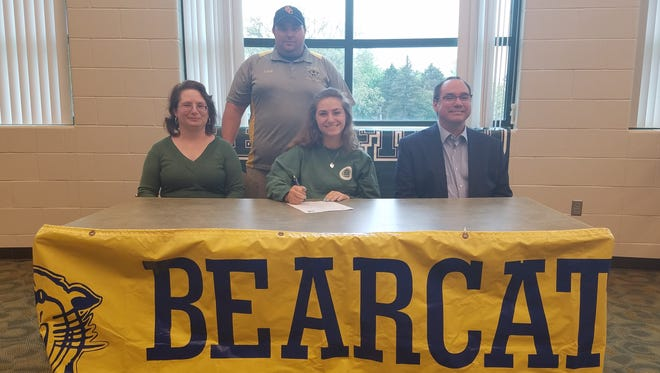 Pennfield's Amber Gauthier signed her National Letter of Intent on May 20 to dive at Illinois Wesleyan University. She is surrounded by her parents - Cynthia Gauthier and Greg Gauthier - as well as Battle Creek Central/Pennfield co-op coach Rob Brownell.