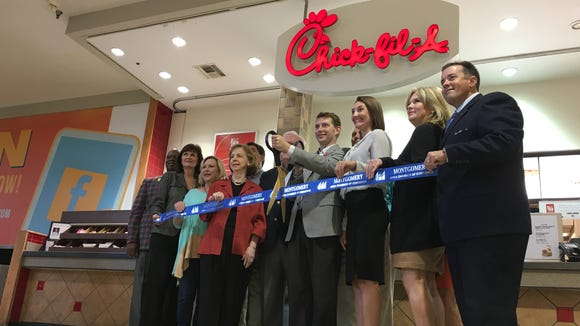 Chick-fil-A and Eastdale Mall representatives celebrate the re-launch of the renovated mall location on Friday.