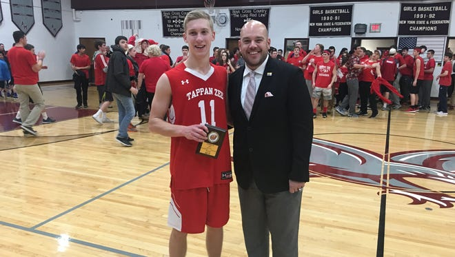 Tappan Zee won a thrilling game, 50-49, at Albertus Magnus. Senior Kieran Gibson, pictured with Saunders coach Anthony Nicodemo, was named game MVP.