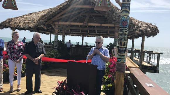 Mark Waltrip, chief operating officer of Westgate Resorts, right, talks about the newly renovated Rikki Tiki Tavern at the Cocoa Beach Pier. At left are Jaqueline and David Siegel, founder and chief executive officer of Westgate Resorts.