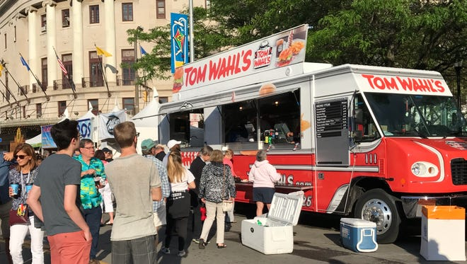 The Tom Wahl's food truck serves hamburgers and hot dogs on Main Street.